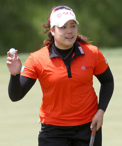 Ariya Jutanugarn reacts after hitting a birdie putt on the 18th home duirng the first round of the Kingsmill Championship Thursday in WIlliamsburg.
