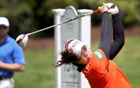 Ariya Jutanugarn tees off on the 15th hole Thursday during the first round of the Kingsmill Championship in Williamsburg. Jutanugarn finished in first place at 7 under for the day.