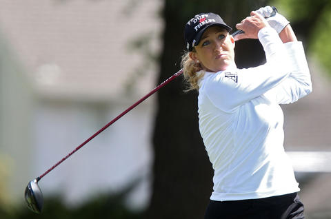 Cristie Kerr tees off on the ninth hole during the first round of the Kingsmill Championship Thursday in Williamsburg. Kerr finished in second at 5 under for the day.