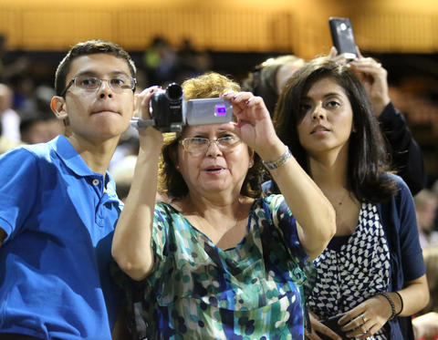 Family members takes pictures of their graduates during the commencement ceremony for the College of Health and Public Affairs and the College of Medicine's Burnett School of Biomedical Science,  at the University of Central Florida, in Orlando, Fla., Thursday, May 2, 2013. (Joe Burbank/Orlando Sentinel) newsgate CCI ID: B582892466Z.1