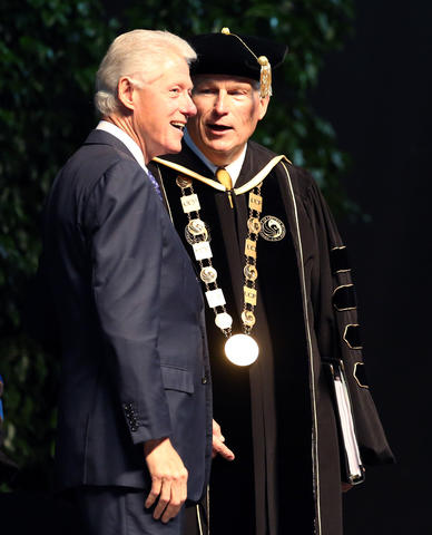 Former president Bill Clinton with University of Central Florida president Dr. John Hitt during the commencement ceremony for the College of Health and Public Affairs and the College of Medicine's Burnett School of Biomedical Science, at UCF in Orlando, Fla., Thursday, May 2, 2013. (Joe Burbank/Orlando Sentinel) newsgate CCI ID: B582892466Z.1