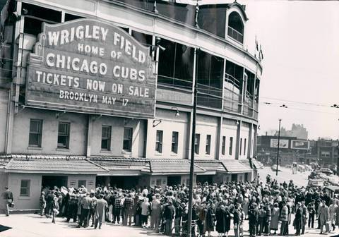 Wrigley Field patrons line up to buy tickets for the Cubs opener against the Pirates. Bright skies brought upwards of 30,000 to cheer on the Cubs.