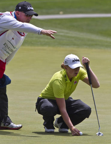 LPGA tournament at Kingsmill in James City Co. the 2nd. round Friday. Stacy Lewis is getting some help lining up her last putt on the 18th green.