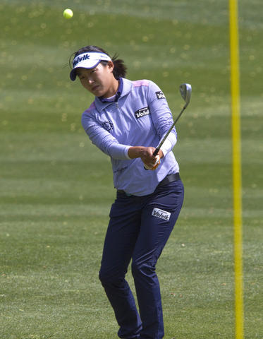 LPGA tournament at Kingsmill in James City Co. the 2nd. round Friday. Ilhee Lee chipping to the 15th. green.