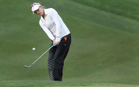 Lexi Thompson chips up to the ninth green during the second round of the Kingsmill Championship Friday in Williamsburg.