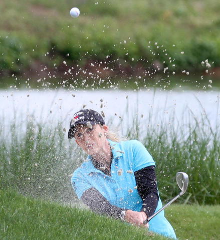 Cristie Kerr hits out of the bunker on the tenth hole as she starts the second round of the Kingsmill Championship Friday in Williamsburg. Kerr finished that day in fourth at 5 under par.
