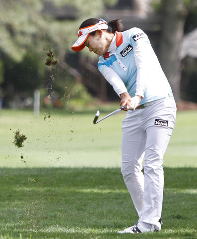 Ilhee Lee kicks up a divot while playing the 12th hole during the third round of the LPGA Kingsmill Championship on Saturday, May 4.