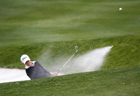 Mo Martin hits out of a bunker on the second hole during the third round of the LPGA Kingsmill Championship on Saturday, May 4.