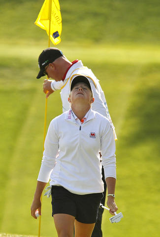 Stacy Lewis reacts in frustration after finishing the seventeenth hole during Saturday's third round of the LPGA Kingsmill Championship.