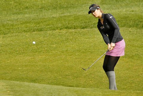 Sandra Gal chips the ball onto the green of the eighth hole during Saturday's third round of the LPGA Kingsmill Championship.