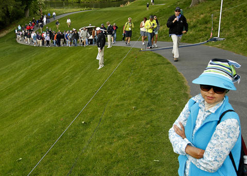 Tety Hanifah, right, of Williamsburg watches play on the 13th hole during Saturday's third round of the LPGA Kingsmill Championship.