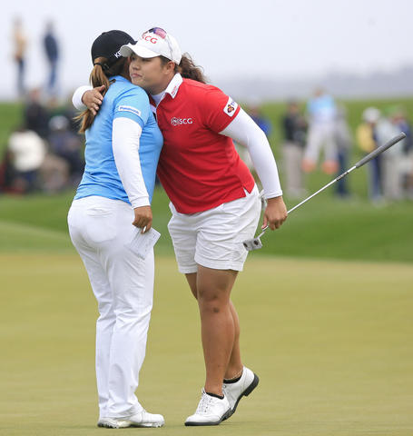 Ariya Jutanugarn, right, hugs Inbee Park after completing the 18th hole at the final round of the LPGA Kingsmill Championship on Sunday, May 5.