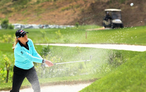 Cristie Herr hits out of the bunker on the 5th hole during final round of the Kingsmill Championship Sunday in Williamsburg.