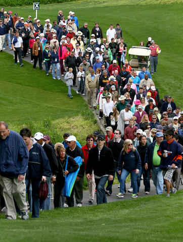 A large gallery follows Cristie Kerr and Suzann Petterson on the fouth hole during the final round of the Kingsmill Championship Sunday in Williamsburg.