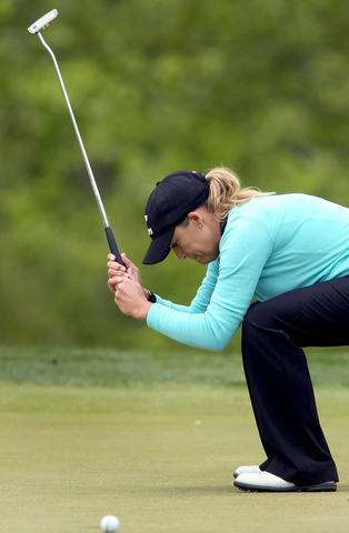 Cristie Kerr reacts after just missing a birdie putt on the 15th hole during the final round of the Kingsmill Championship Sunday in Williamsburg.