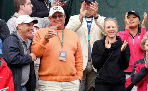 Michael Kerr raises a glass to his daughter Cristie after she won the Kingsmill Championship Sunday in Williamsburg beating Suzann Petterson after two play-off holes.