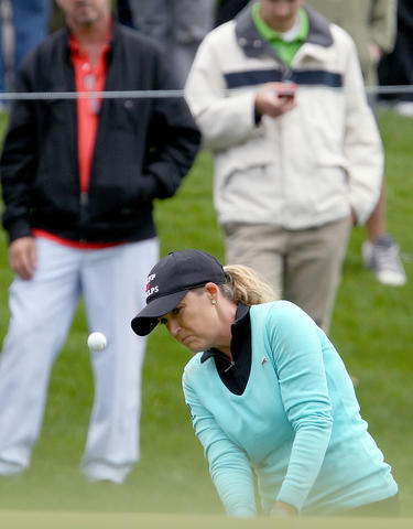 Chistie Kerr chips up to the green on the fourth hole during the final round of the Kingsmill Championship Sunday in Williamsburg.