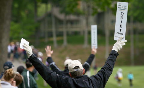 Volunteer marshals quiet the crowd on the seventh hole during the final round of the Kingsmill Championship Sunday in Williamsburg.