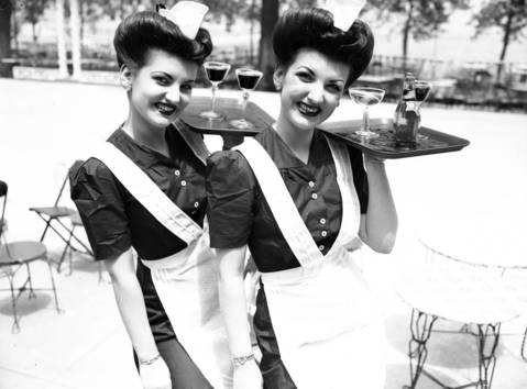 Twins Lou and Lee Lamkins, age 20, just accepted jobs as waitresses at the pool at Edgewater Beach Hotel, June 21, 1945.