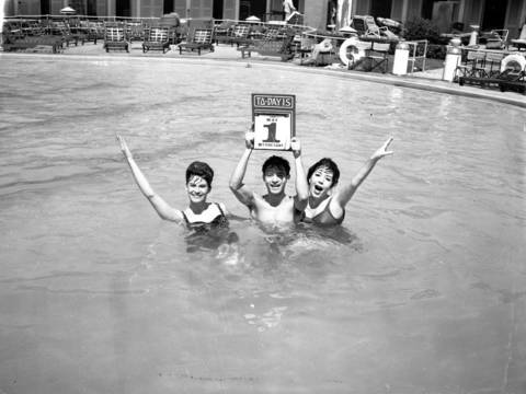 Entertainers Davine Miraballi, from left, Jimmy Dybas and Eleni Sarafi at the opening of the Edgewater Beach Hotel swimming pool on May 1, 1963.