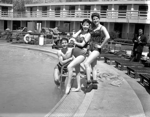 Entertainers Jimmy Dybas, from left, Eleni Sarafi, and Davine Miraballi at the season opening of the Edgewater Beach Hotel swimming pool on May 1, 1963.