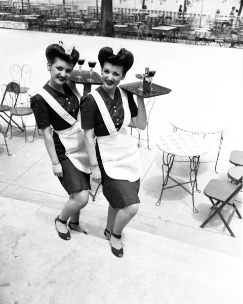 Twins Lou and Lee Lamkins, age 20, just accepted jobs as waitresses at the pool at Edgewater Beach Hotel, photographed on Jun. 21, 1945.