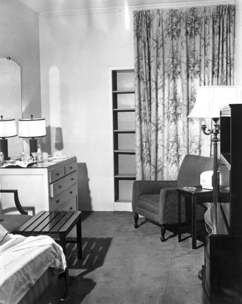Room 1297A at the Edgewater Beach Hotel where baseball player Eddie Waitkus was shot. View shows dresser at left with a martini glass and drink mixes. At right is the chair where Waitkus sat when Ruth Steinhagen fired her rifle.