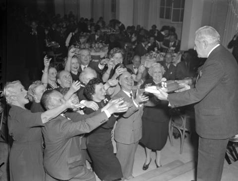 Hotel President Mr. William Dewey hands out gifts to 10-year and longer employees at the Edgewater Beach Hotel's annual employee dinner, Mar. 27, 1947.