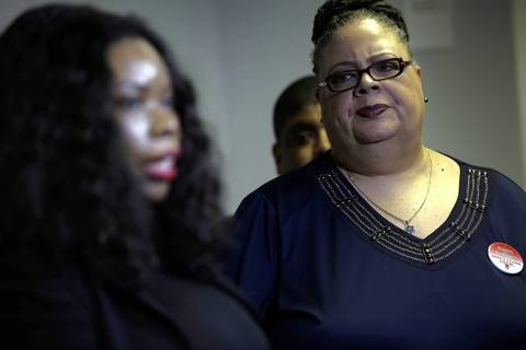 Chicago Teachers Union president Karen Lewis, right, listens as teachers describe what union officials consider to be systematic neglect of Simon Guggenheim Elementary in West Englewood by Chicago Public Schools prior to putting the school on their closing list during a press conference at CTU headquarters in the Merchandise Mart.