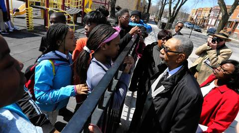 Congressman Bobby Rush, third from right, speaks with students from Genevieve Melody Elementary School during a school closings bus tour attended by Chicago Teachers Union leaders, city and state officials, clergy, parents and media.