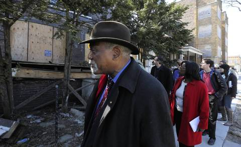 Congressman Danny Davis, center, joins Chicago Teachers Union leaders, city and state officials, clergy, parents and media, as they walk pass several abandon and boarded up buildings during their walk to Melody and Delano Elementary Schools. The group was walking through the area to see what school children see on their way to and from school.