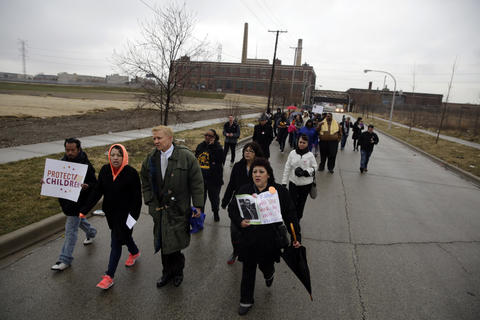 """Ald. Bob Fioretti, 2nd, center, joins about 30 members of the Raise Your Hand Coalition, Blocks Together and Save Our Neighborhood Schools as they """"Walk the Walk"""" from William H. King Elementary, 740 S. Campbell Ave., to Jensen Elementary Scholastic Academy, 3030 W. Harrison St. Chicago Public Schools proposed closing King Elementary and sending those students to Jensen Academy about 1 mile away - a distance the coalition says is too dangerous to walk."""