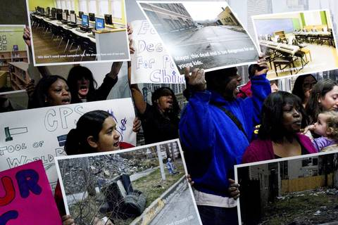 Parents protest against school closings at City Hall in Chicago.