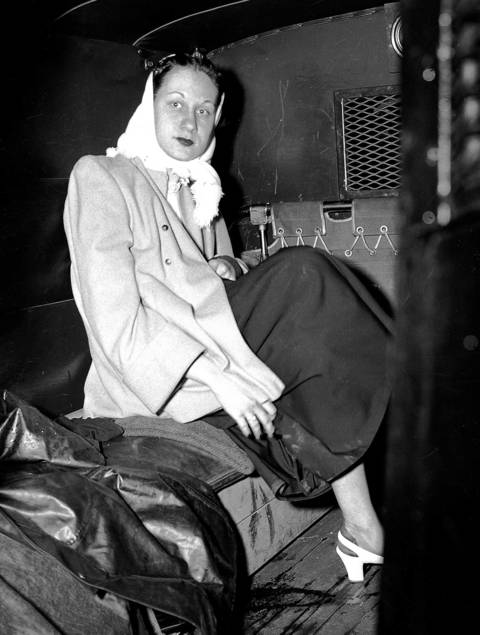 Ruth Steinhagen is taken away in a police wagon after shooting Phillies first baseman Eddie Waitkus in 1949. Steinhagen, 19, had developed an obsession for Waitkus. She checked into the Edgewater Beach Hotel in Chicago and had a note sent to Waitkus' room, saying she had to see him. When he arrived at her 12th-floor room, she shot him in the chest, just below the heart. He eventually recovered and played for six more seasons. Steinhagen was declared insane and committed to Kankakee State Hospital. In 1952 she was judged sane and freed.
