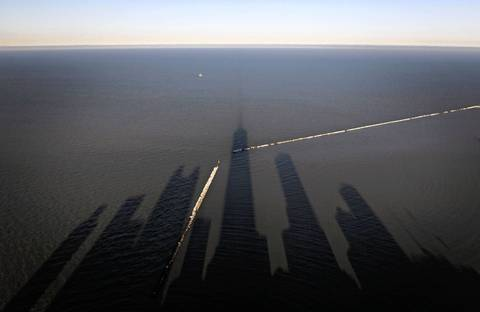 The late day sun casts shadows on Lake Michigan.