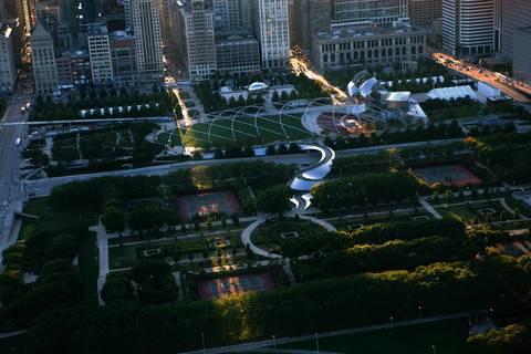 Millennium Park is highlighted by later afternoon sun streaming between the buildings on Michigan Avenue.