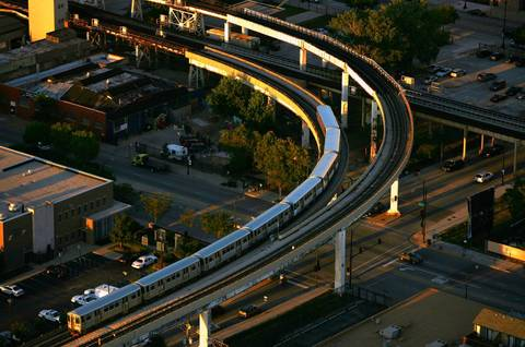 An orange line CTA train on the elevated tracks at 18th and State Streets.