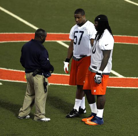 Bears draft picks Jonathan Bostic (57) and Khaseem Greene with equipment manager Tony Medlin on the first day of Bears rookie minicamp.