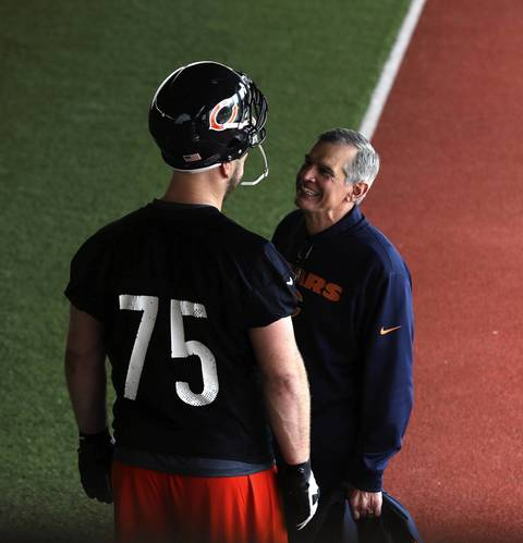 First round draft pick Kyle Long with GM Phil Emery after practice Friday.