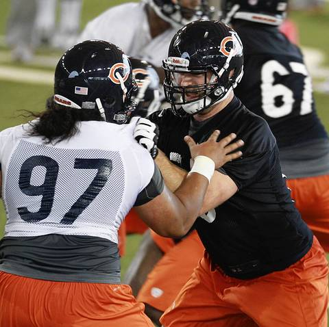 Offensive guard Kyle Long (right) works on his blocking against Christian Tupou.