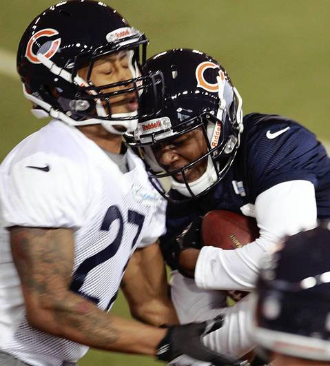 Wide receiver Terrence Toliver (right) collides with cornerback Maurice Jones.