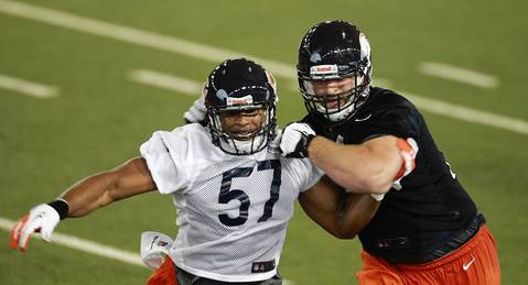 Linebacker Jonathan Bostic fights off offensive guard Kyle Long.