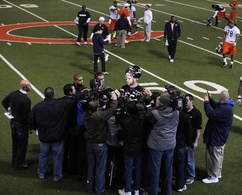 The media surrounds Kyle Long after the first day of rookie minicamp.