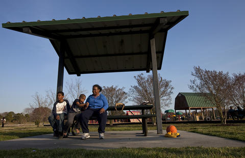 Tim (center) sits with Titus and Eva, showing his discontent after running through a mud puddle at Riverview Farm Park in Newport News on March 30.
