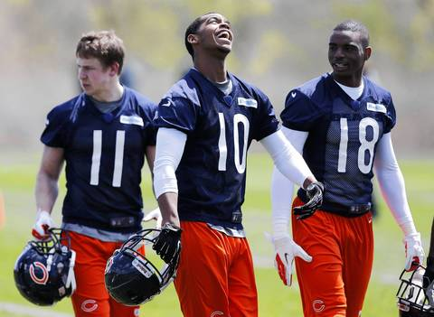 Wide receivers Marquess Wilson is all smiles as he walks off the field with Marcus Rucker (18) and Josh Lenz (11) at the end of rookie minicamp.