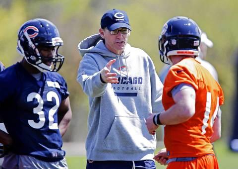 Marc Trestman talks with quarterback Jimmy Coy.
