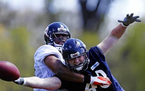Linebacker Jonathan Bostic (57) defends fullback Kellen Bartlett (48).