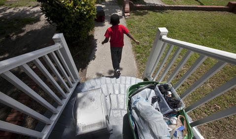 Tim runs down the front path of his family's new house as Eva and Tim move their belongings inside on May 3.