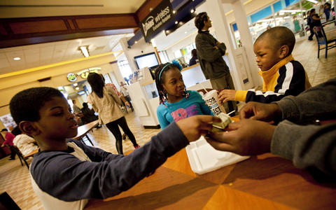 The Williams children negotiate lunch at the food court of Patrick Henry Mall in Newport News on March 30.