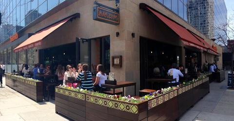 Tavernita's bar, Barcito, features a sidewalk patio and glass walls that open up on warm days.